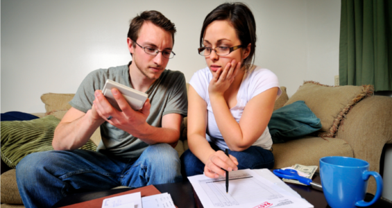 Couple calculating debts